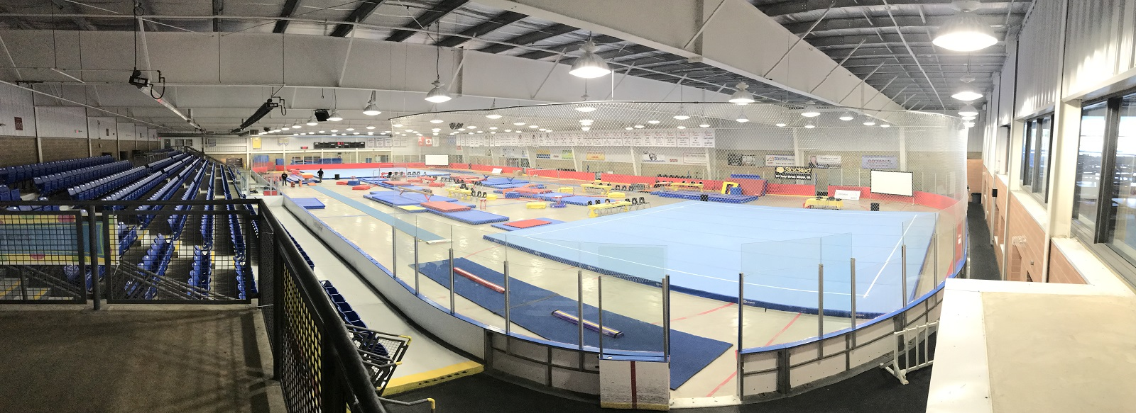 Gymnastics event set up in arena.